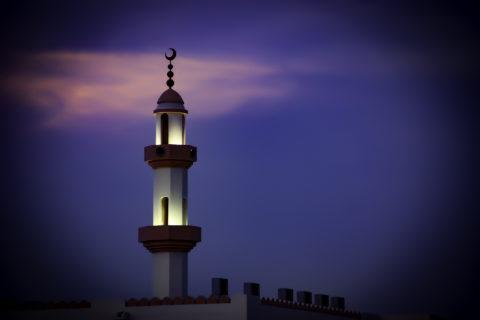 The minaret of a neighborhood mosque in Doha around sunset. Adam Hodges