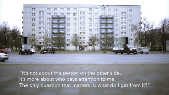 """lanscape photo of an 8-story apartment building with a mostly empty parking lot in front. Text at the bottom of the photo reads, """"It's not about the person on the other side, it's more about who pays attention to me. The only question that matters is: what do I get from it?"""""""