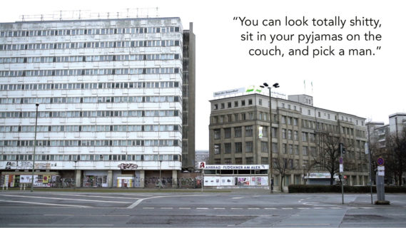 """A photo of two office buildings taken from across the street. There are no cars or people in the photo, and no leaves on the tree in the median of the road. The text in the photo, a quote from an interlocutor, reads: """"You can look totally shitty, sit in your pyjamas on the couch, and pick a man."""""""