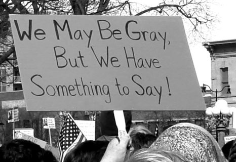 """Sign at a protest that reads, """"We may be gray, but we have something to say!"""""""