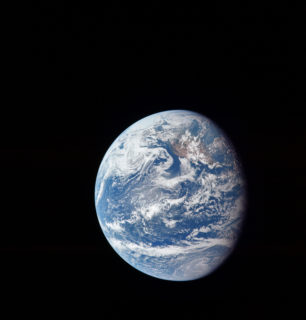 The planet Earth floating alone in outer space.
