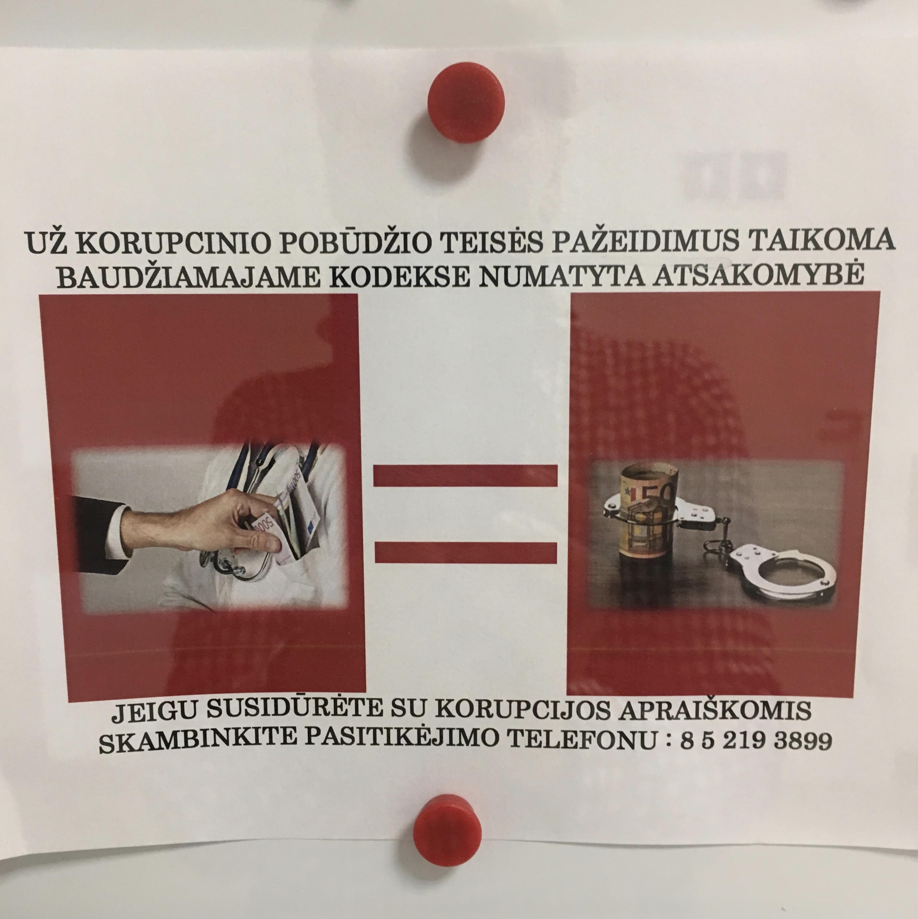"""Photo was taken in Vilnius in 2017. """"Corruption is a crime prosecuted by the Code of Criminal Procedure. If you encountered any signs of corruption, please call this trusted line. """""""
