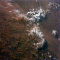 This image, taken on August 1965, by astronauts of the Gemini V mission, illustrates the snowed peaks of the Atlas Mountains, rising on the rigged reddish colorful lands of Morocco.