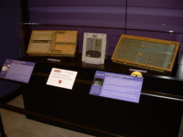 The figure shows the components of the Apollo Guidance Computer. In the center of the image is the input device; it is flanked by the containers for the circuit boards and memory.
