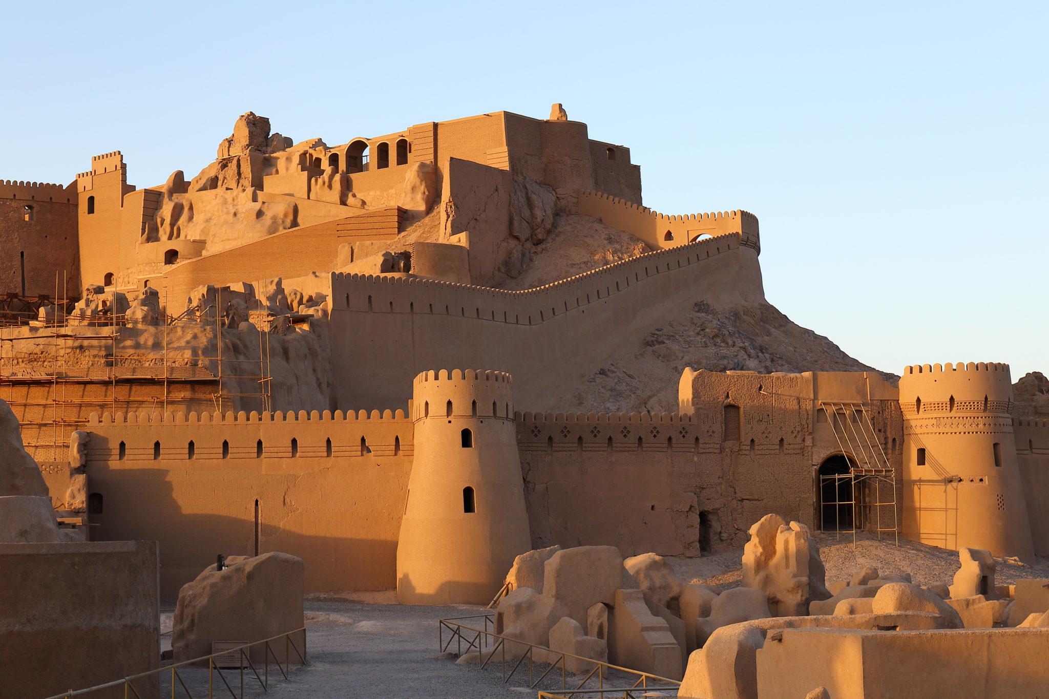 An adobe citadel rising up a hill.