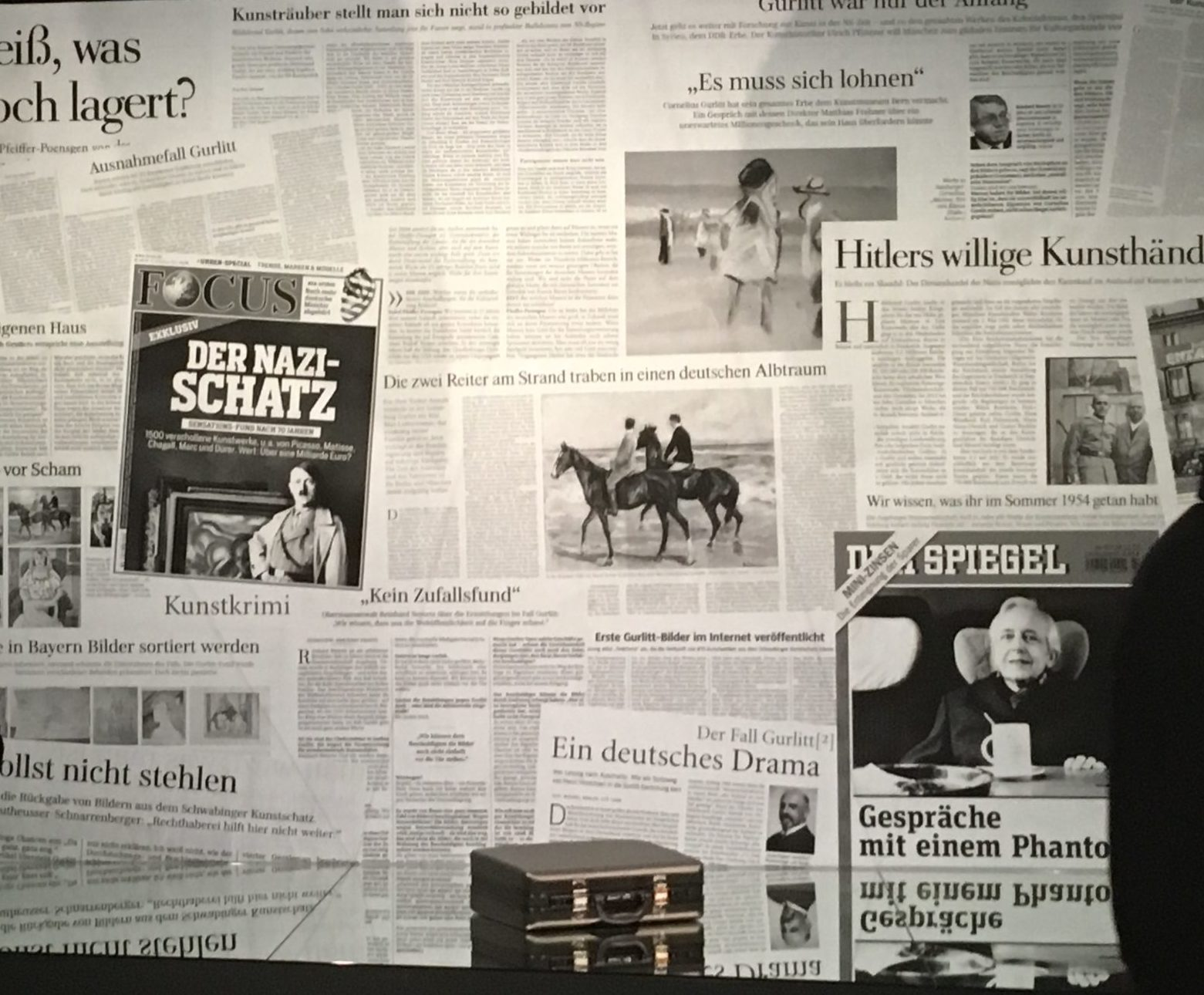 Photograph of a wall of German newspapers.