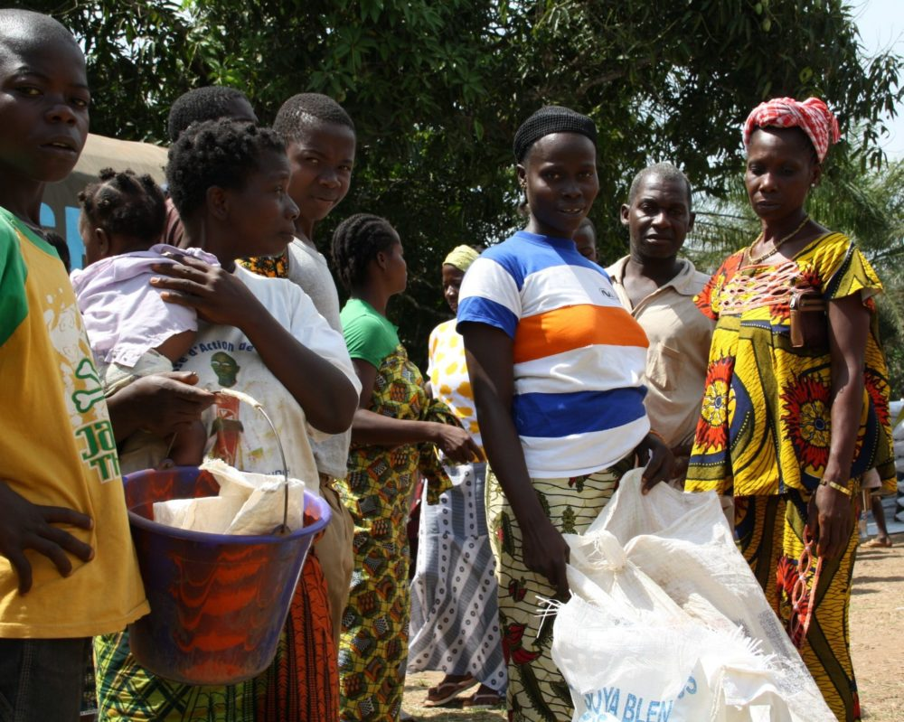 Photo of food distribution taking place at one of 76 Liberian border villages who have taken in Ivorian refugees.
