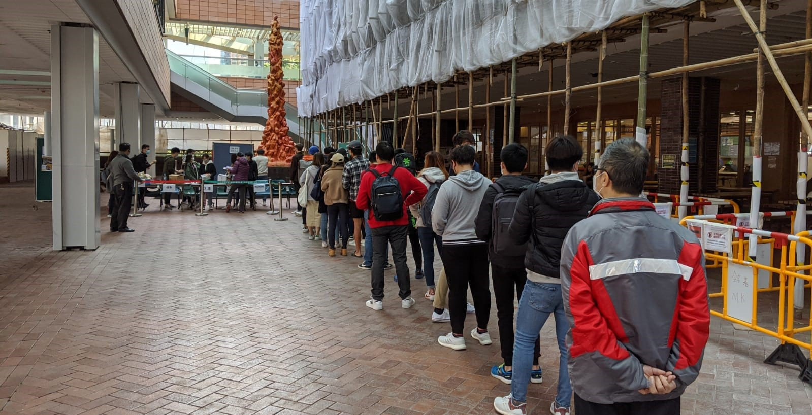 Image depicting people waiting in line