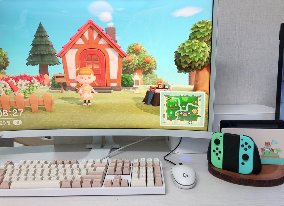 Photo of a computer monitor, keyboard, mouse, and Switch game console.