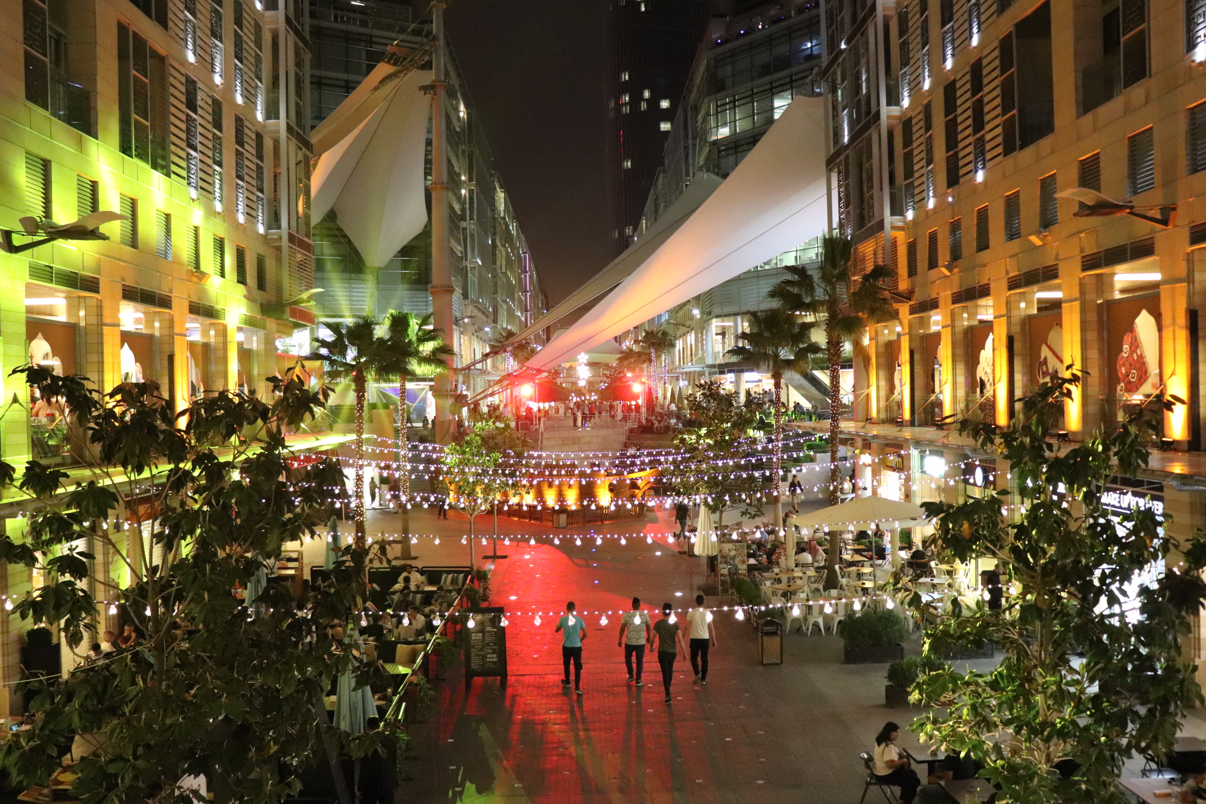 Photograph of a brightly lit boulevard at night.