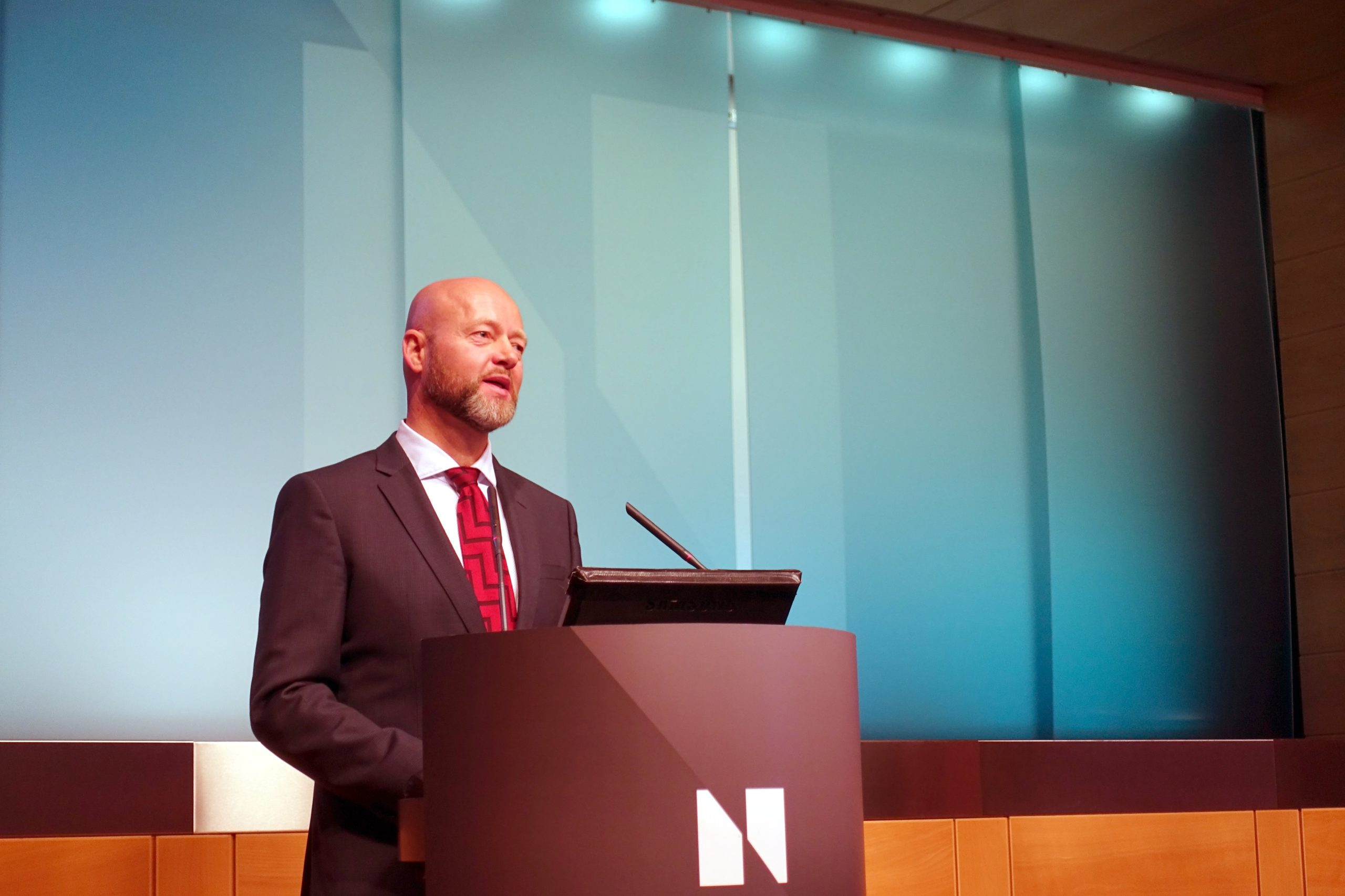 Photograph of someone speaking from a podium