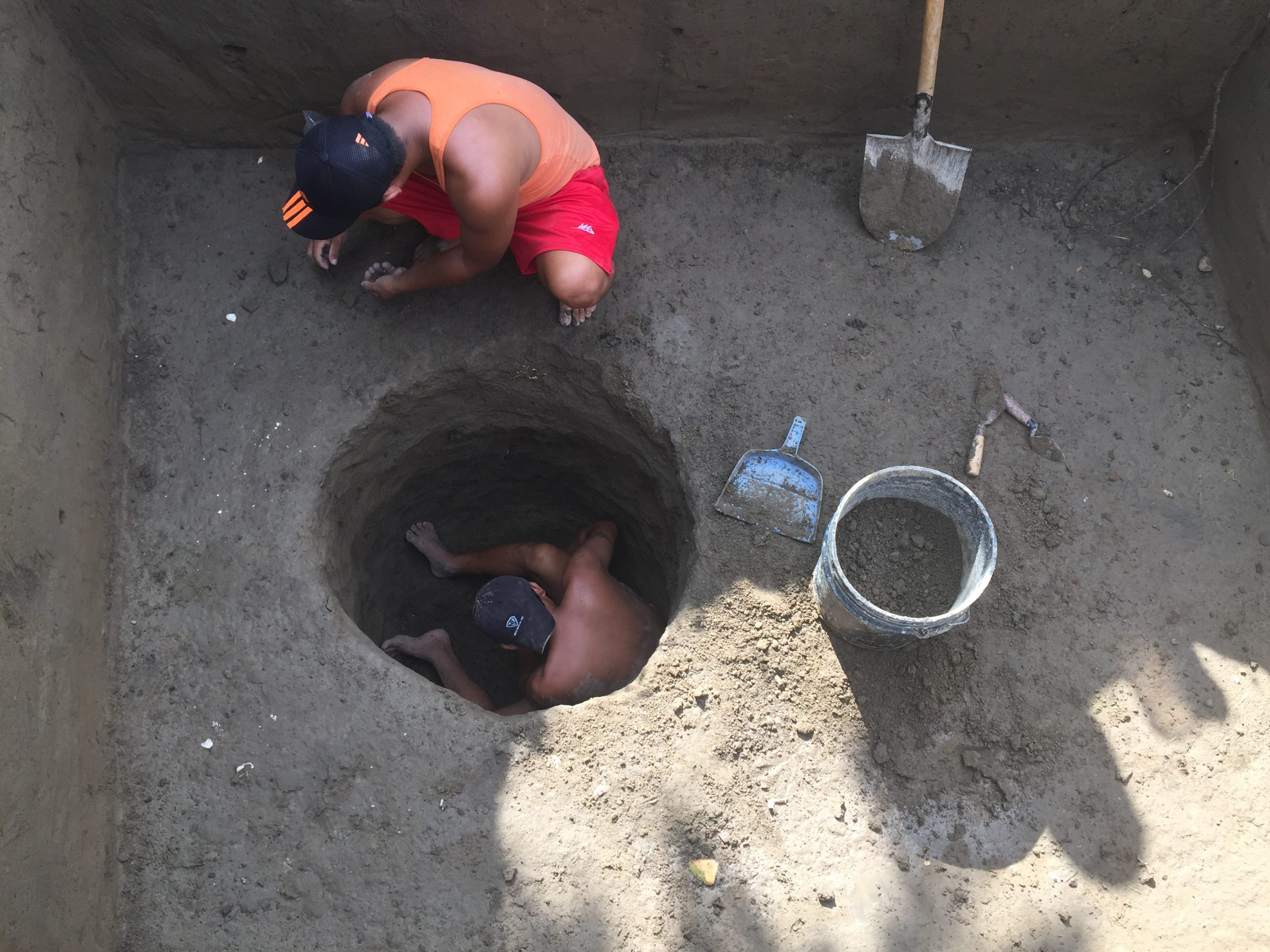 An image of two men excavating at an archaeological site.