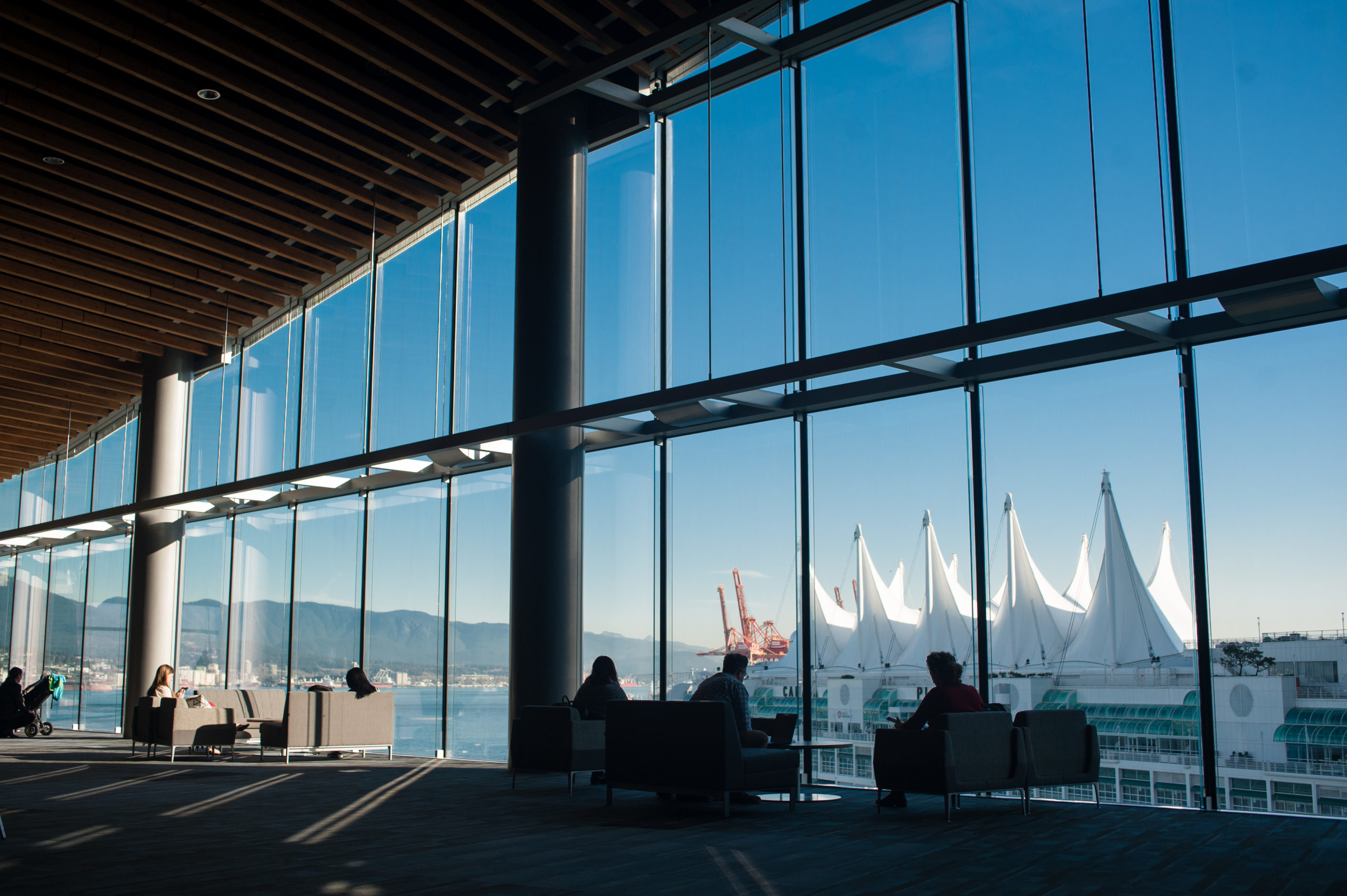 Photo from inside of the Vancouver Convention Center of the outside view through its windows.
