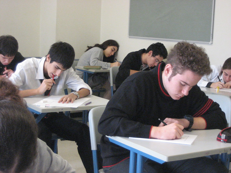 Photograph of people in a classroom.