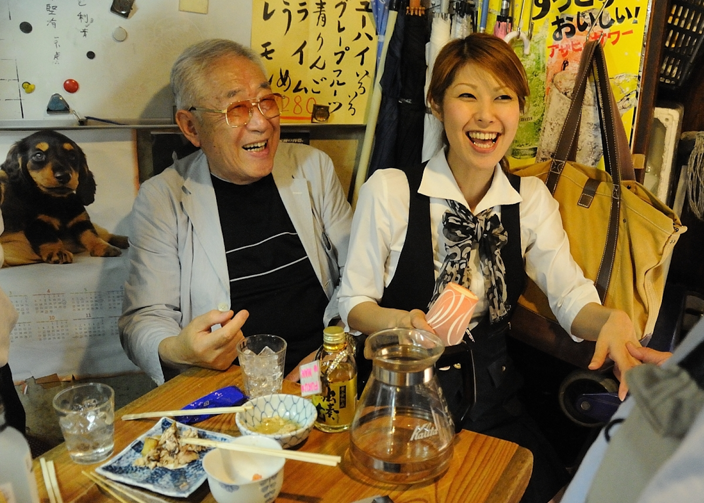 Photograph of two people sitting at a table.