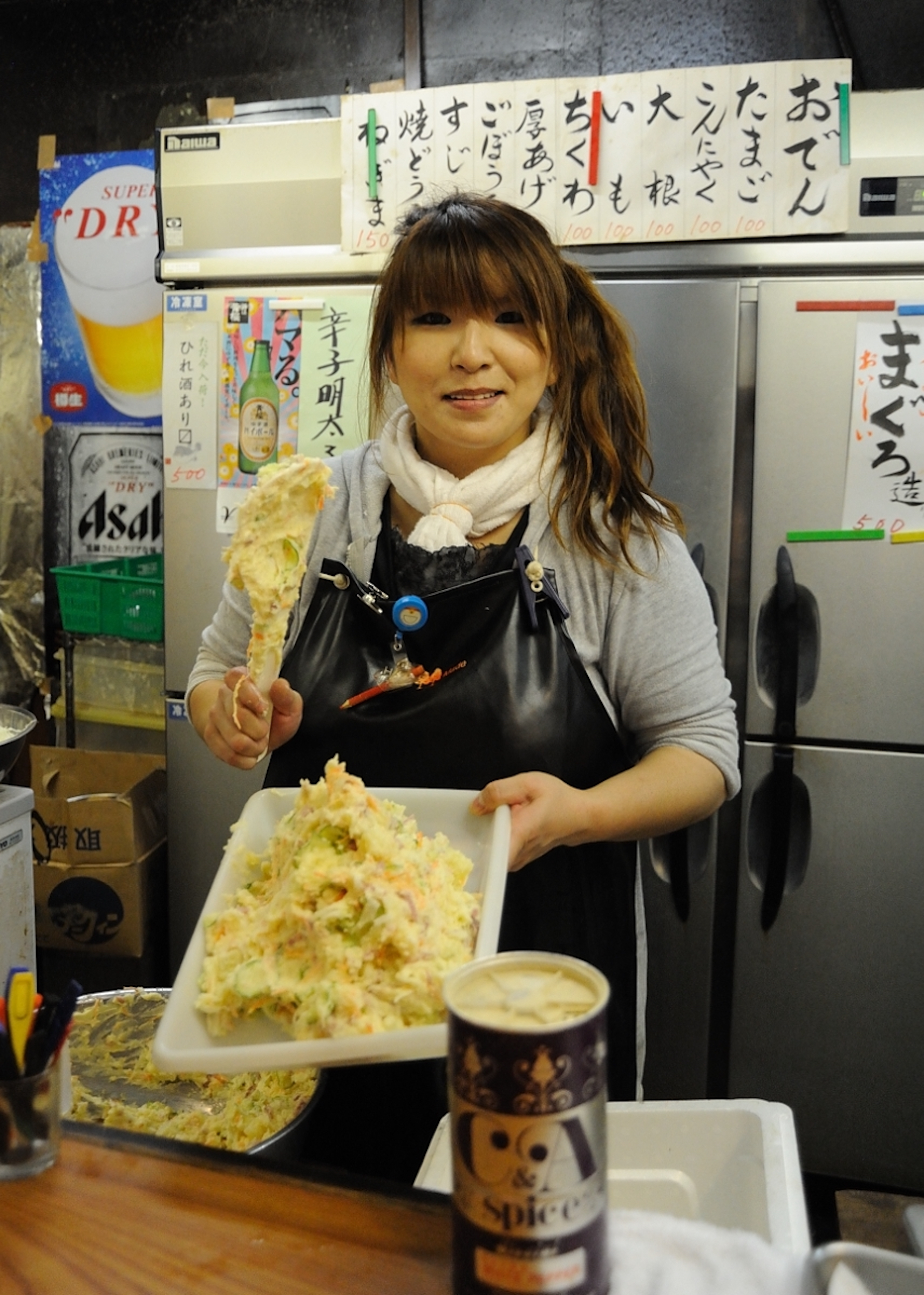Photograph of a woman holding a tray of food