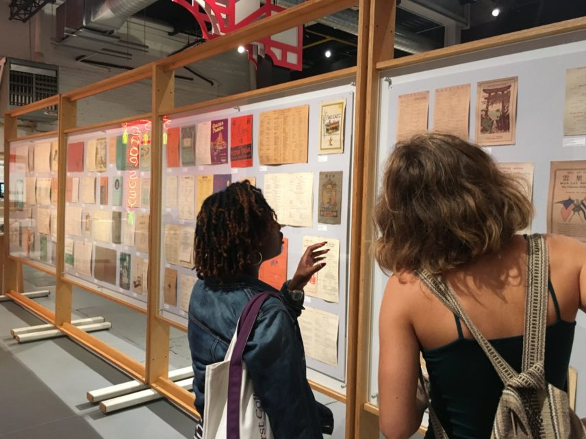 Photograph of two people looking at an exhibit.