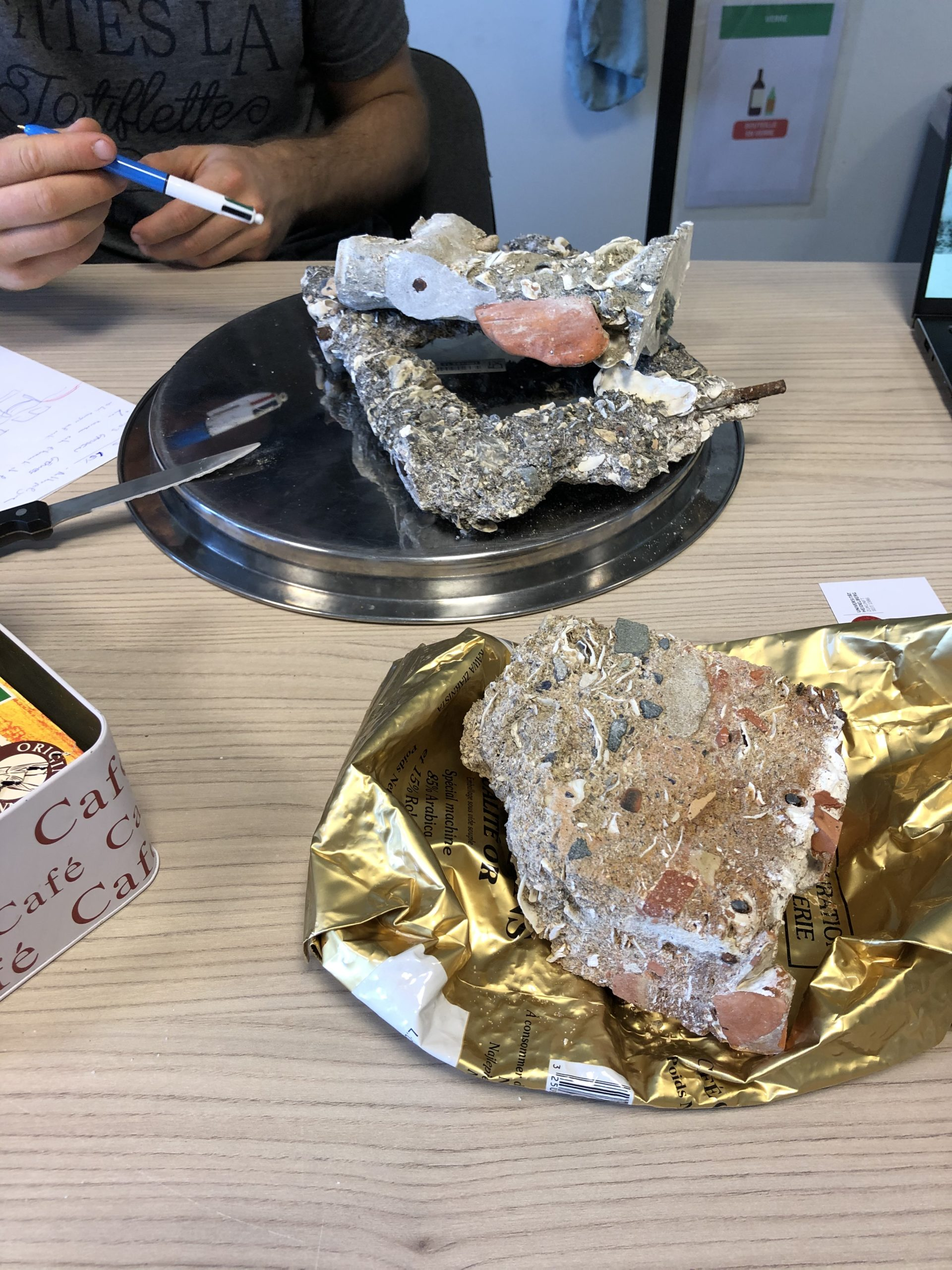 Photograph of concrete and minerals sitting on a table