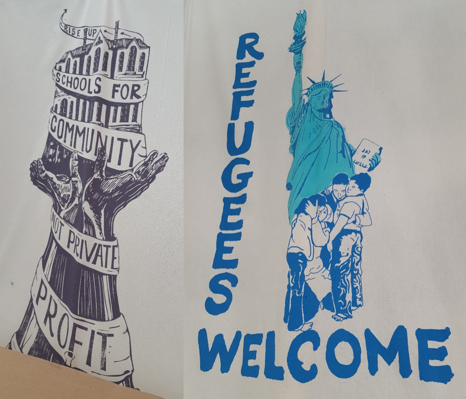 Two illustrated protest signs