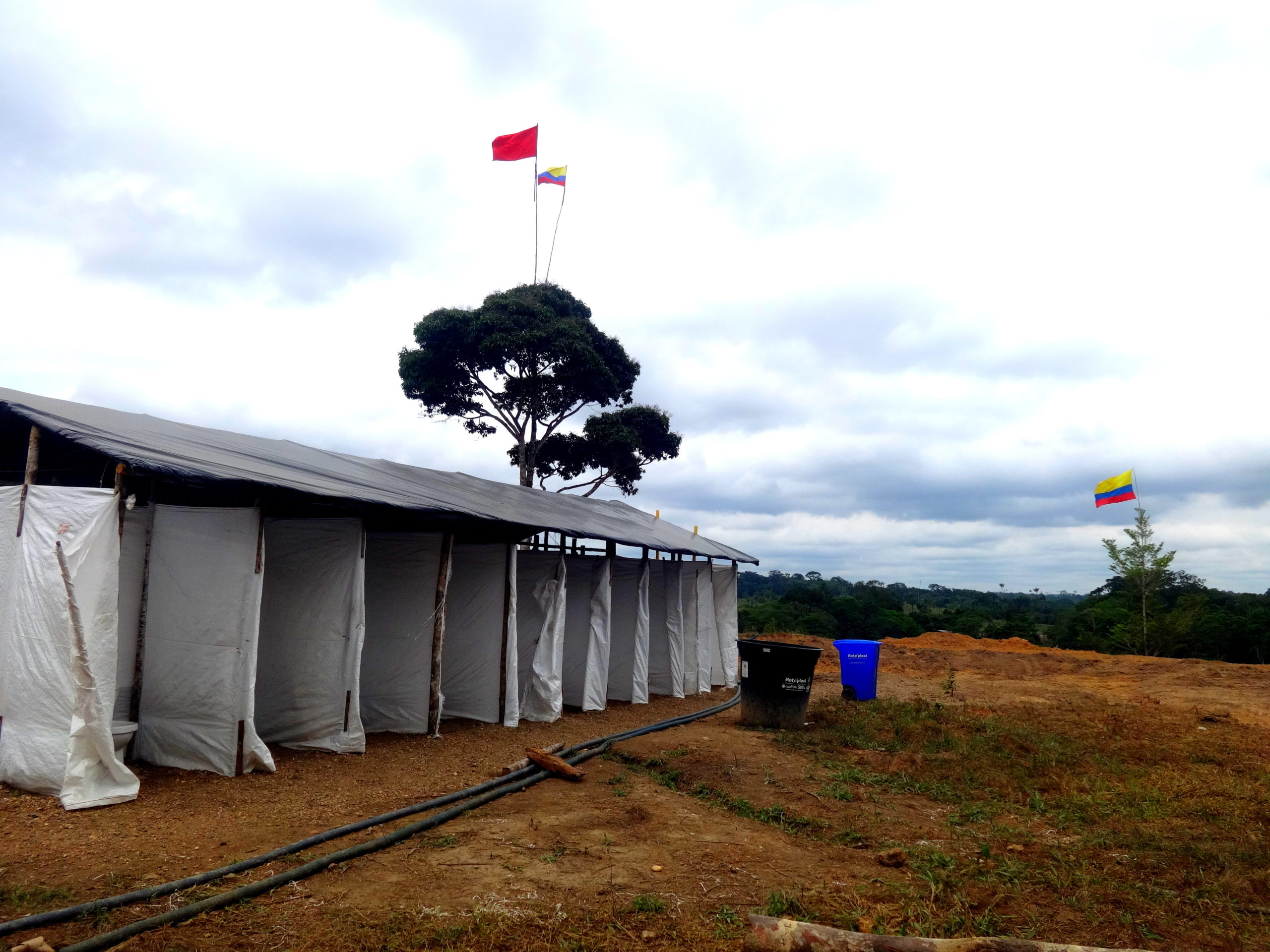 Photograph of temporary showers built in a disarmament camp in Colombia.