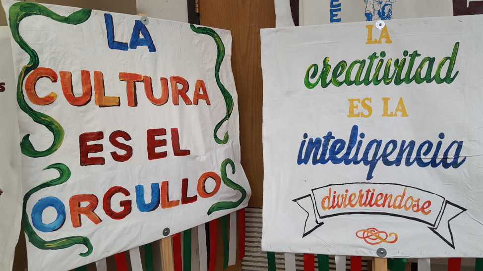 Two student-made signs on display next to each other
