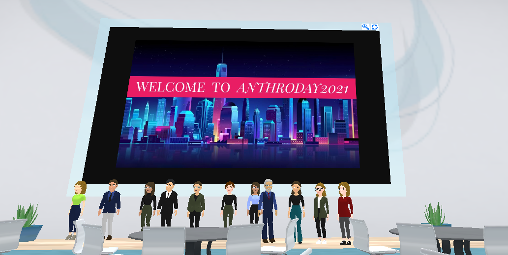 Screenshot of a virtual space including chairs, tables, avatars, and a welcome banner