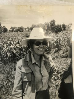 Black and white photograph of a woman outdoors