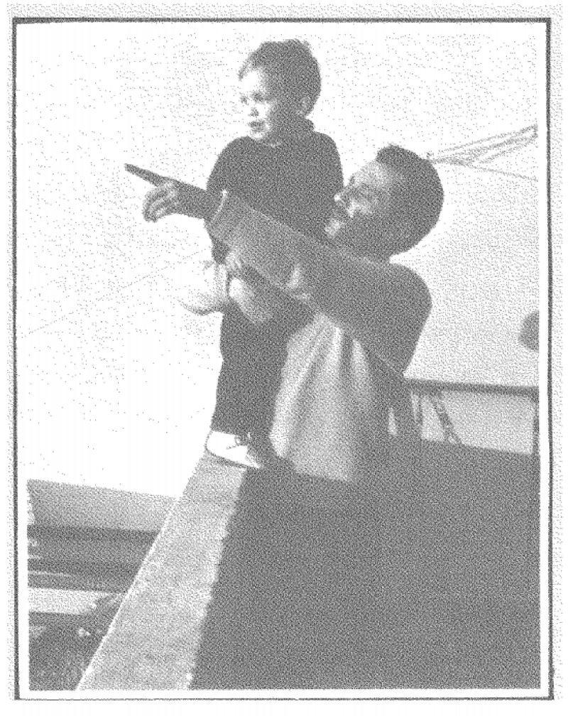 Photograph of a man and a child